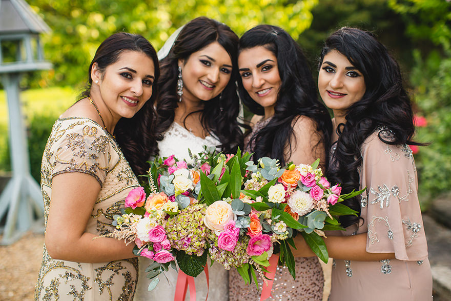 Indian bride and her bridesmaids posing for wedding photos in Surrey