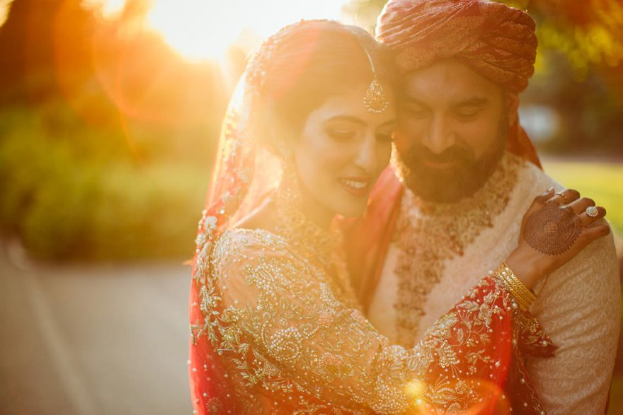 beautiful sunset wedding photo of an asian couple