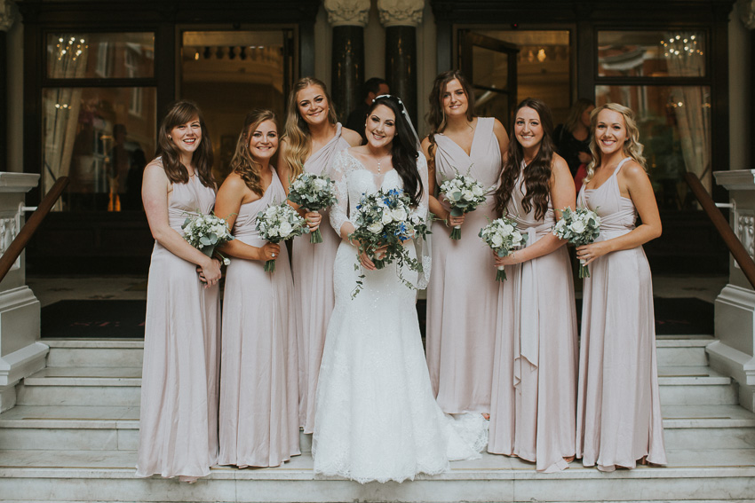 bride and her bridesmaids in front of london hotel