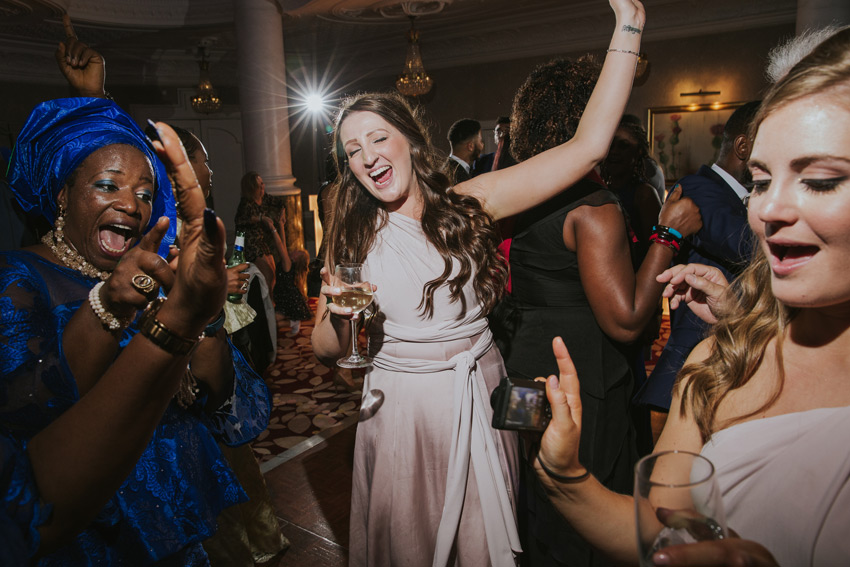 bridesmaid dancing during a wedding in st ermins hotel in london