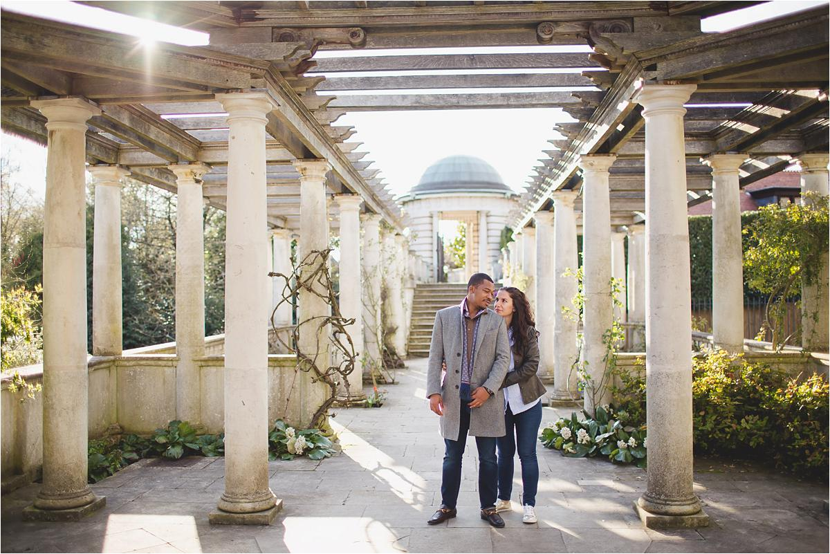 couple posing for their London engagement photos in Hampstead Heath Pergola