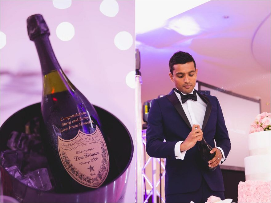 groom opening bottle of don perignion at his asian wedding reception