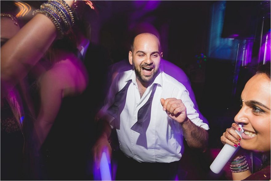 indian happy guy dancing at a wedding