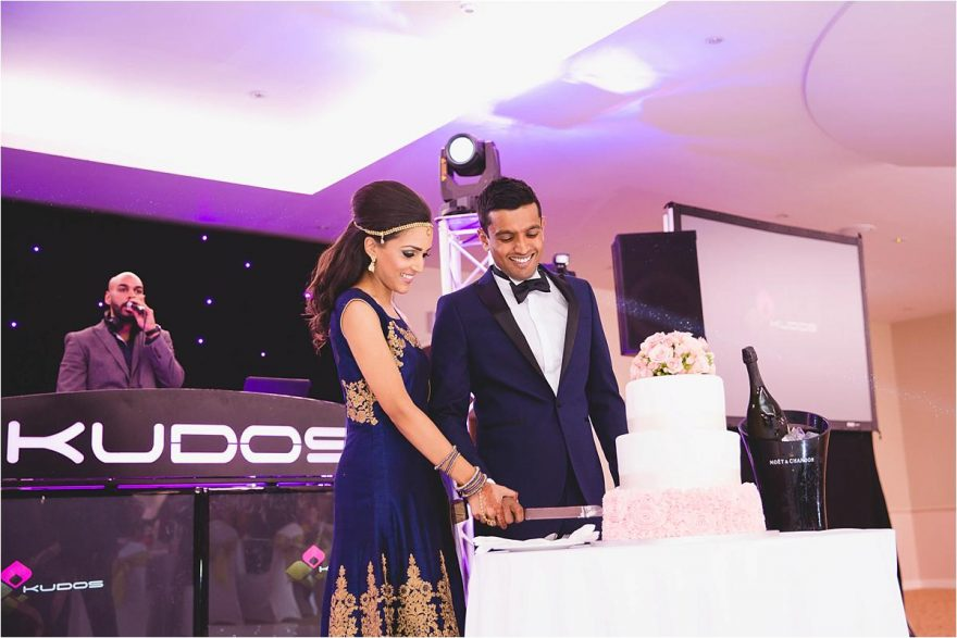 cake cutting at an indian wedding in london