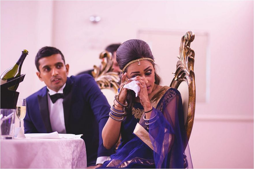 asian bride crying during an emotional wedding speach
