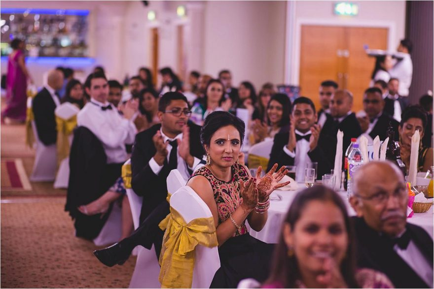 guests clapping at an asian wedding in london