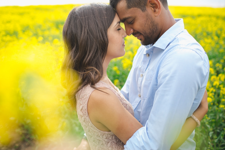 indian couple embracing in the rapeseed fields in Surrey