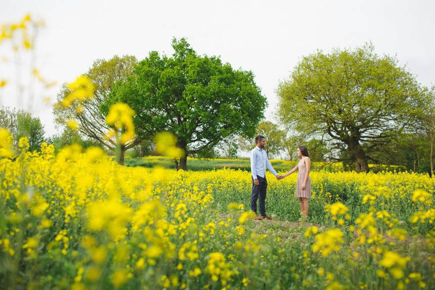 natural engagement photo shoot in rapeseed fields Surrey