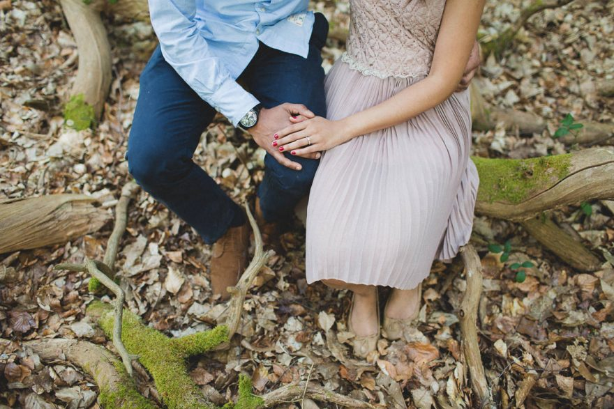 close up of hands and an engagement ring during a forest couple session n Surrey