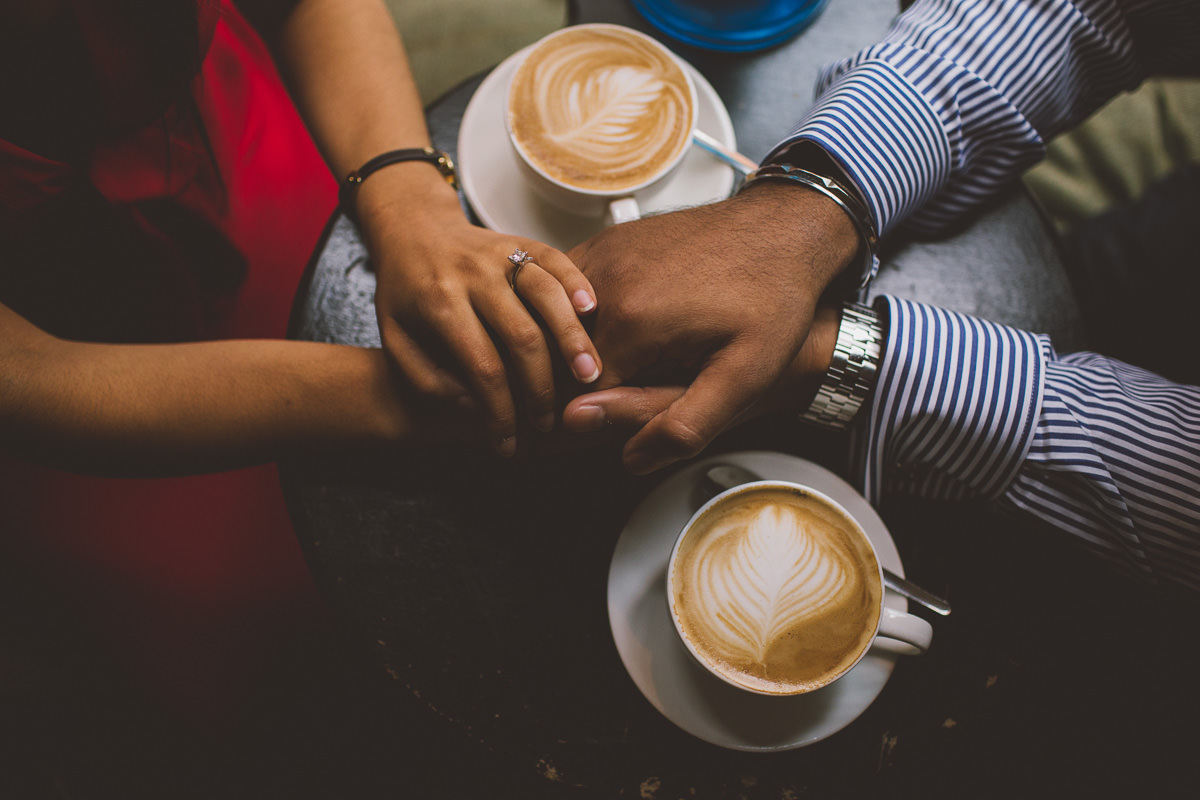 london creative and natural engagement photography close up oh hands over a coffee