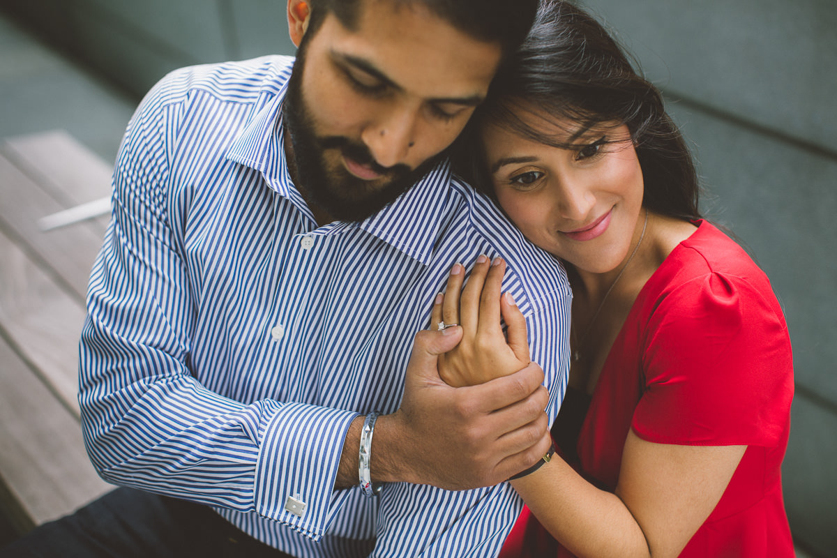 indian couple holding hands and embracing during the couple pre wedding photos in London