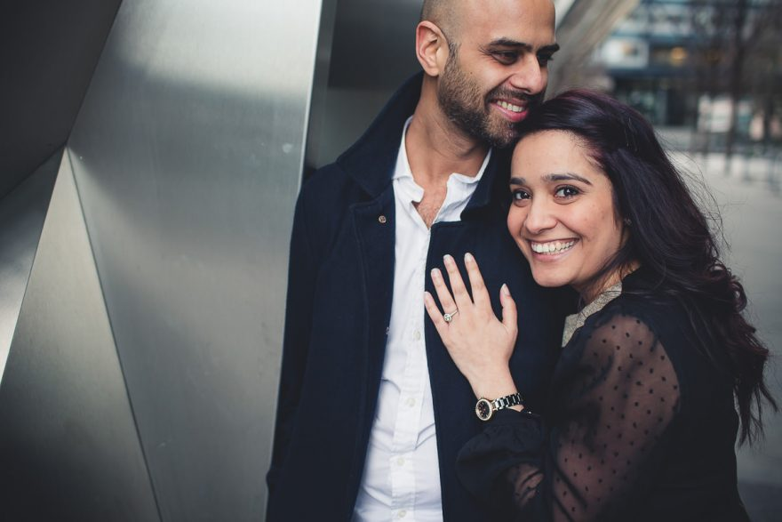 supper smiley caouple posing for their relaxed and elegant engagement photos in London