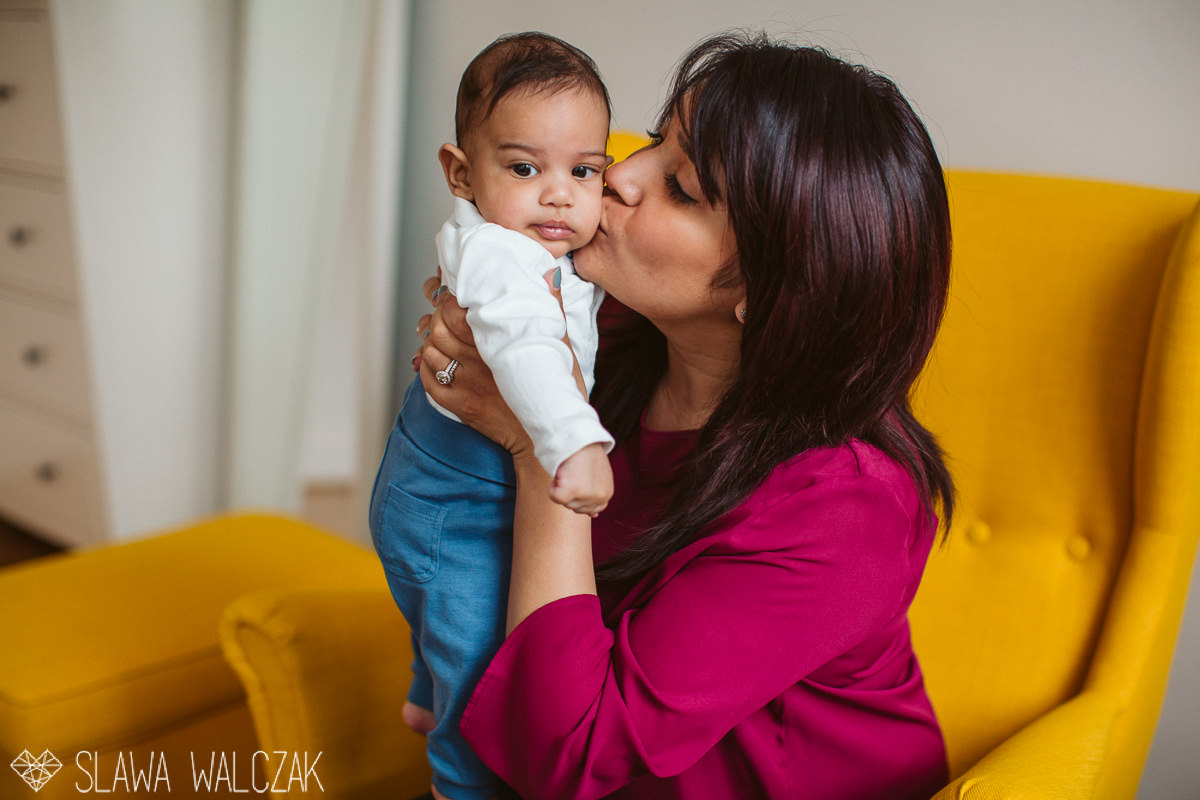 mother kissing her baby during a lifestyle family and materinty photo session in London