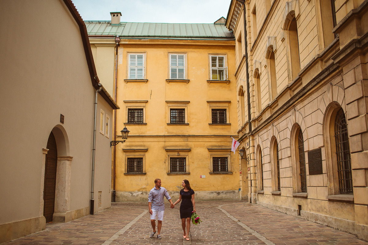 canadian couple posing for their destination engagement photos in Krakow
