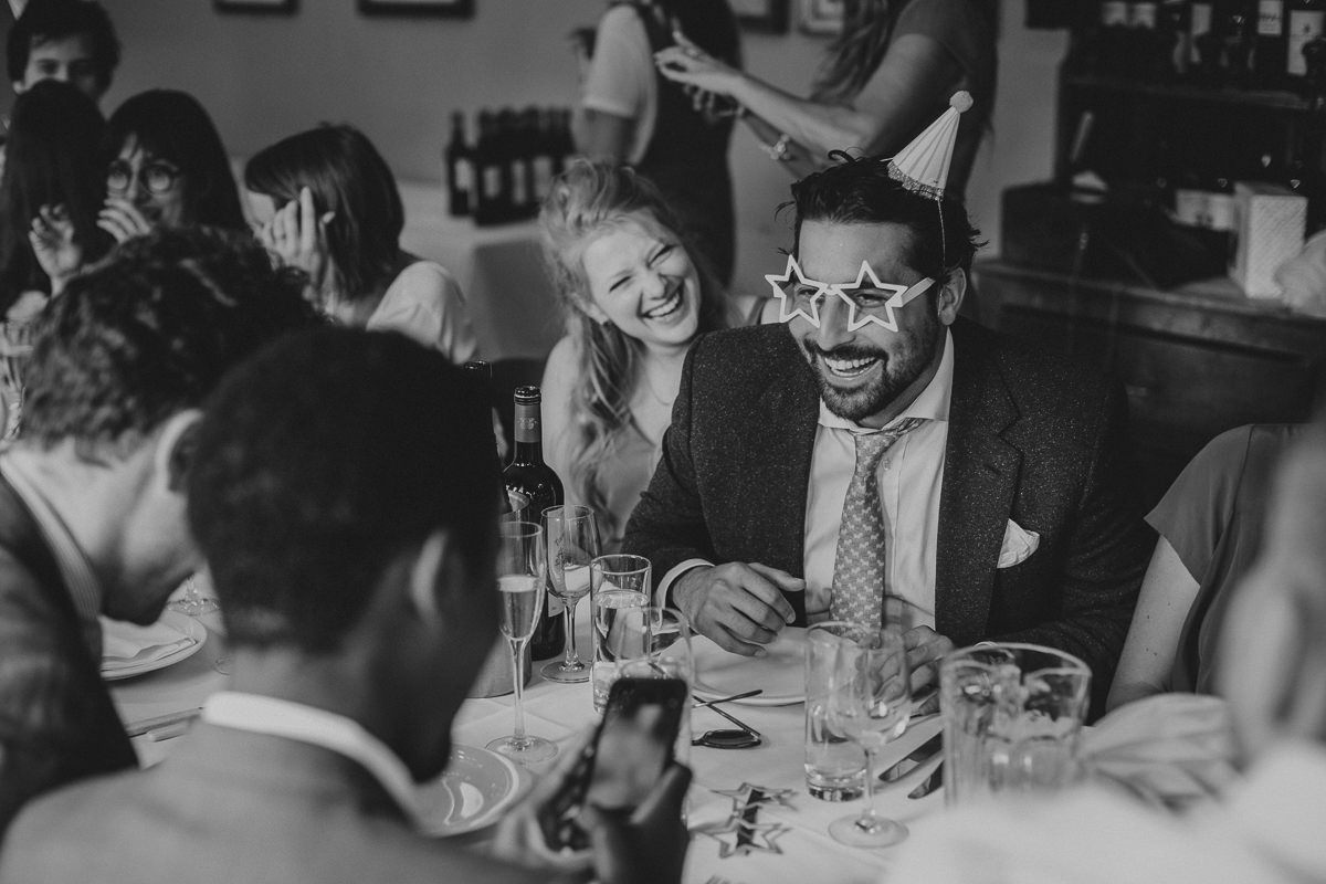 photos of guests having fun at a London wedding in Drapers Arms pub