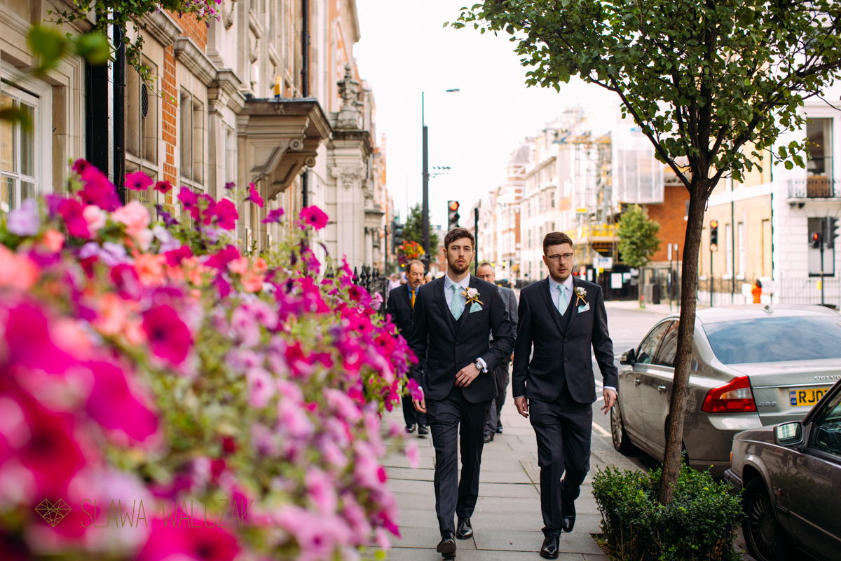 Groom and his brother walk to Asia House for a wedding