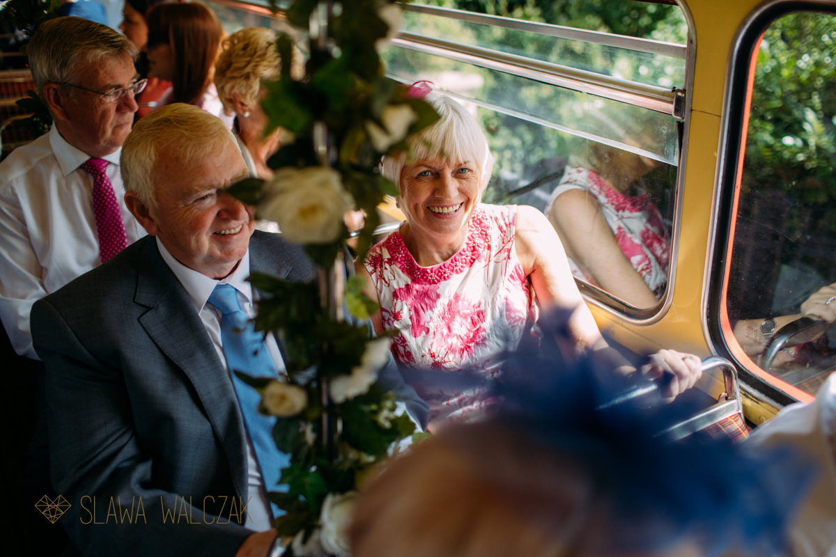 wedding guests on a journey on London Routemaster bus
