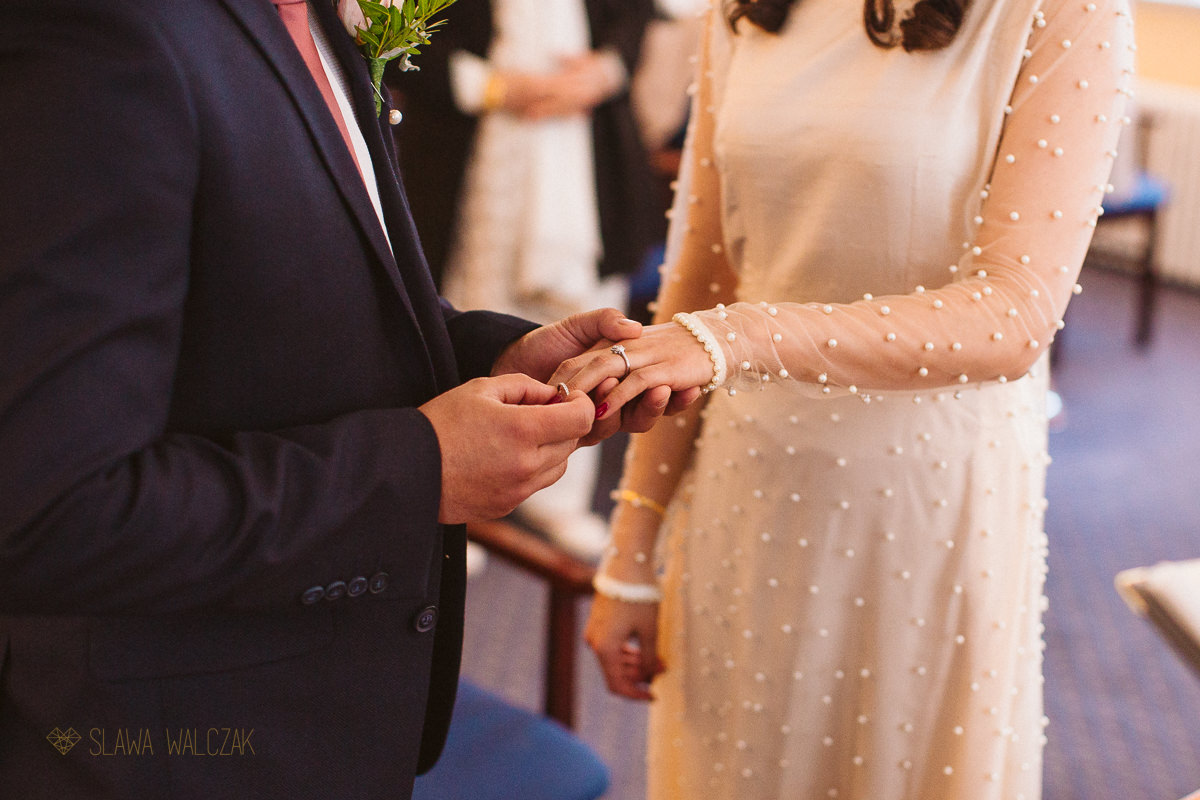 detail shot of the ring exchange at a civil wedding in Ealing Register Office