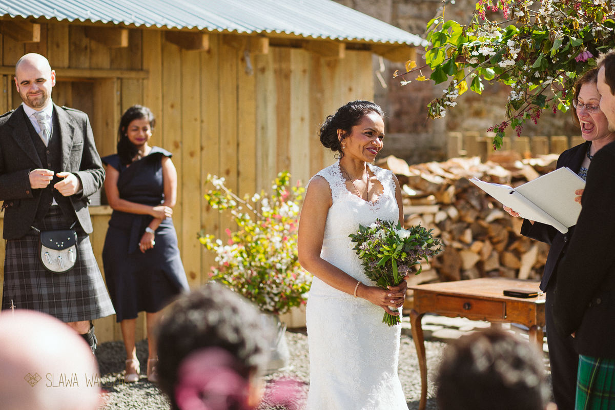 outdoor humanist ceremony during a farmhouse Wedding in Scotland