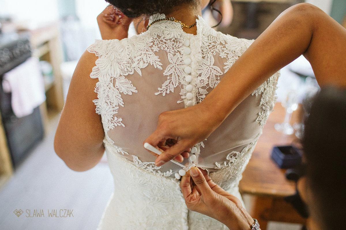 bride putting on her wedding dress at Cockdurno Farm Wedding Photography Edinburgh Scotland