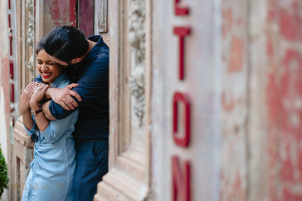 cute indian couple posing for their relaxed pre wedding photos in Wapping London