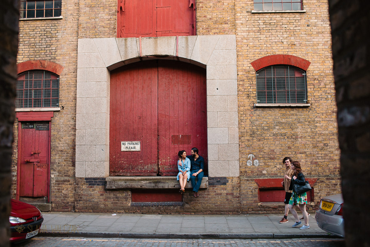 indian couple posing for their relaxed pre wedding photos on Wapping Wharf