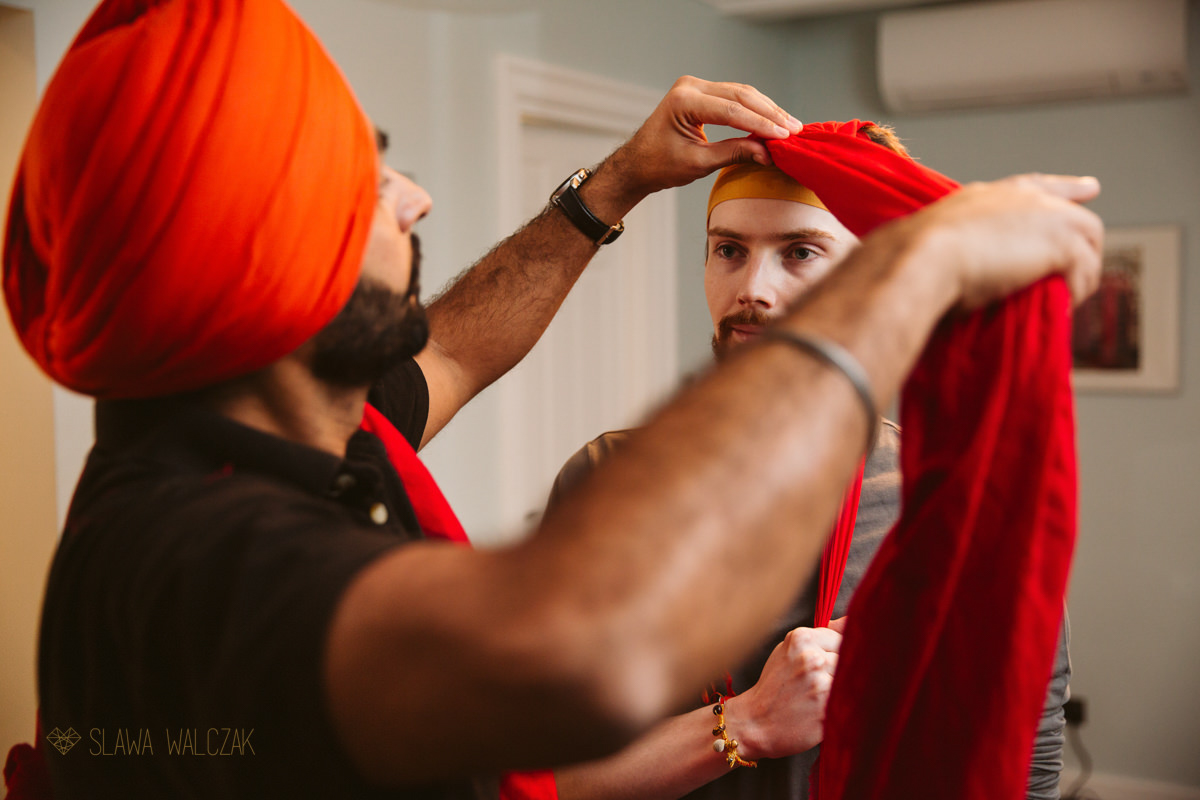 Groom getting ready for his sikh wedding in London