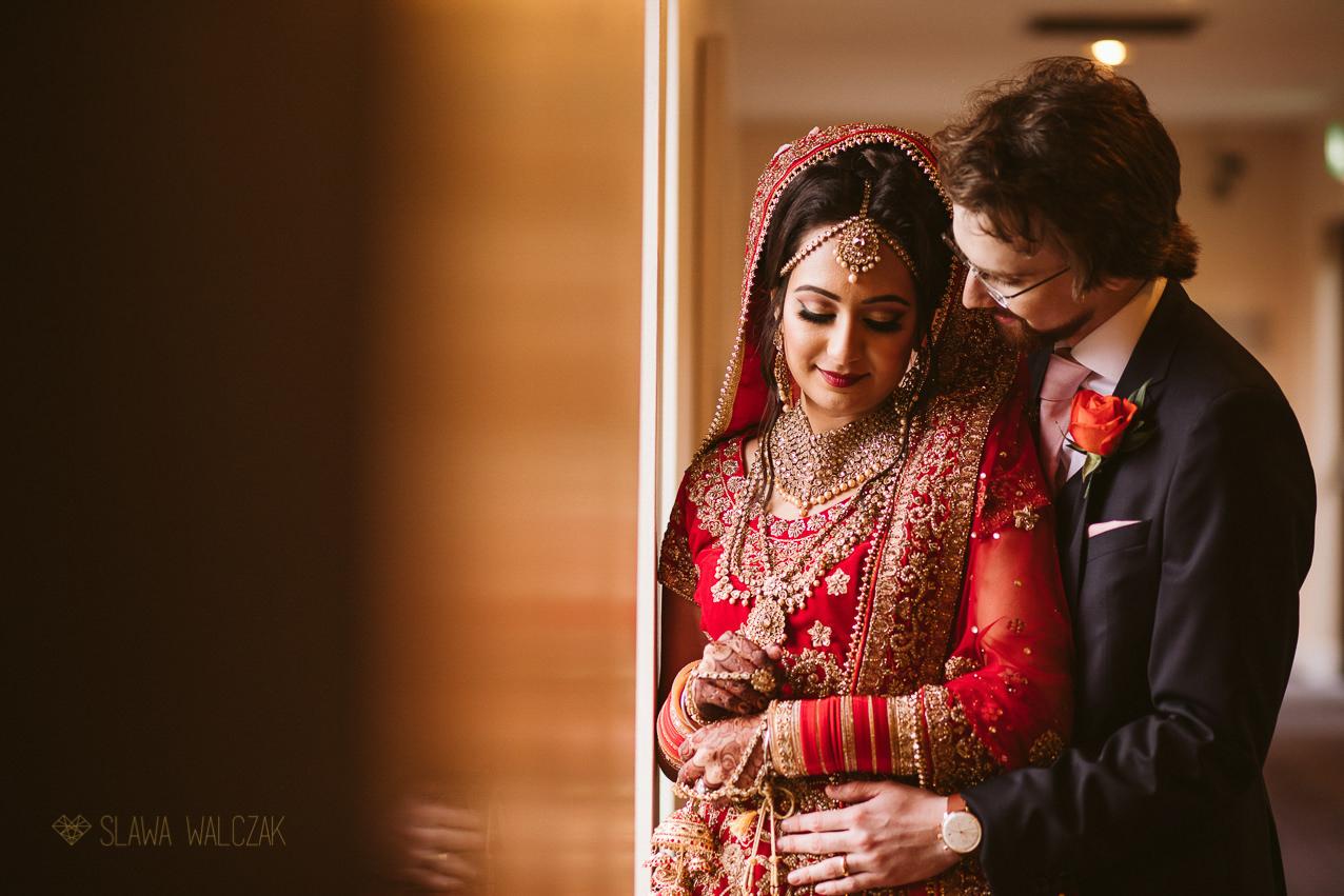 Indian bride having her Vidai during her Sikh wedding in London