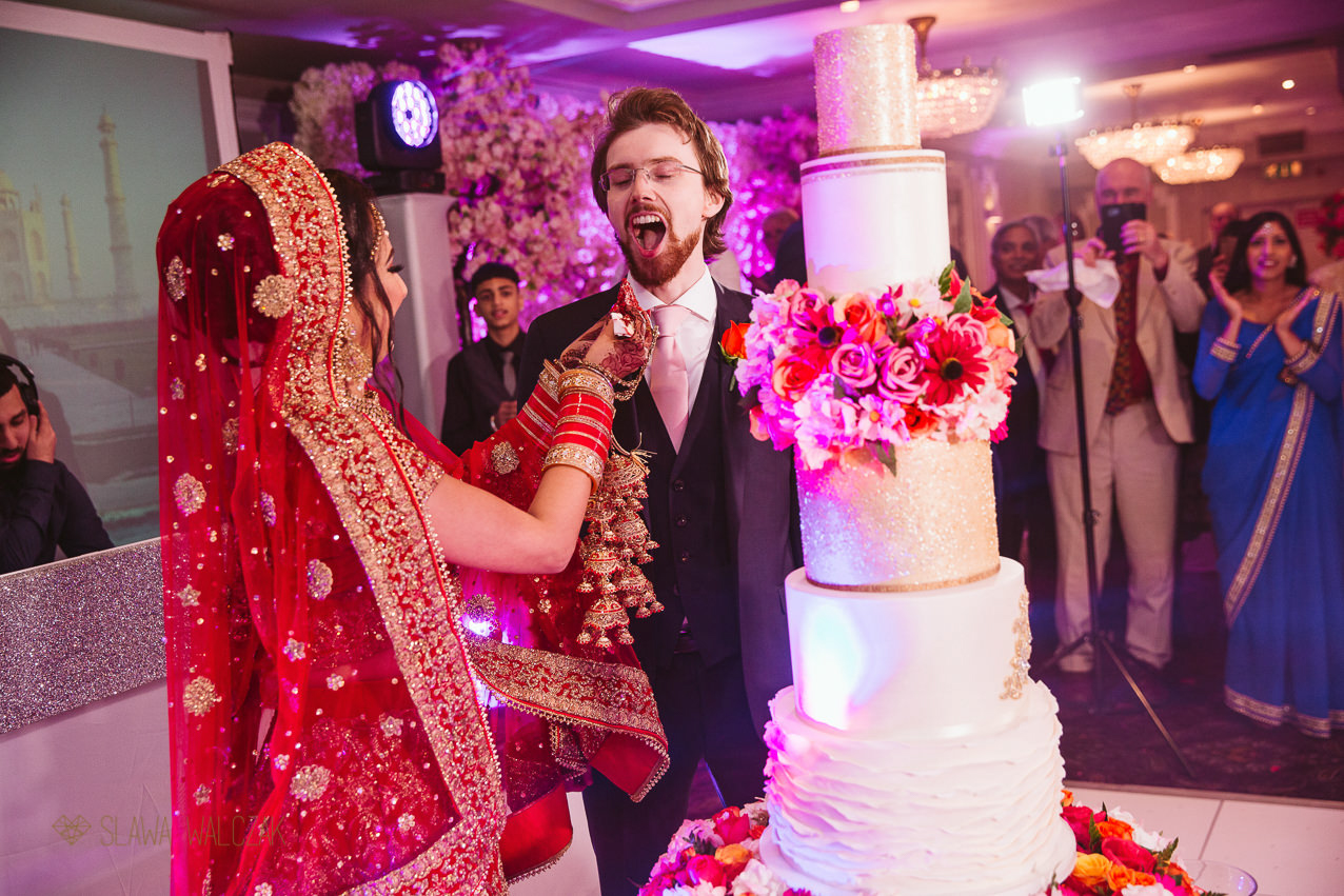 documentary photography from a cake cutting at an Indian wedding in London
