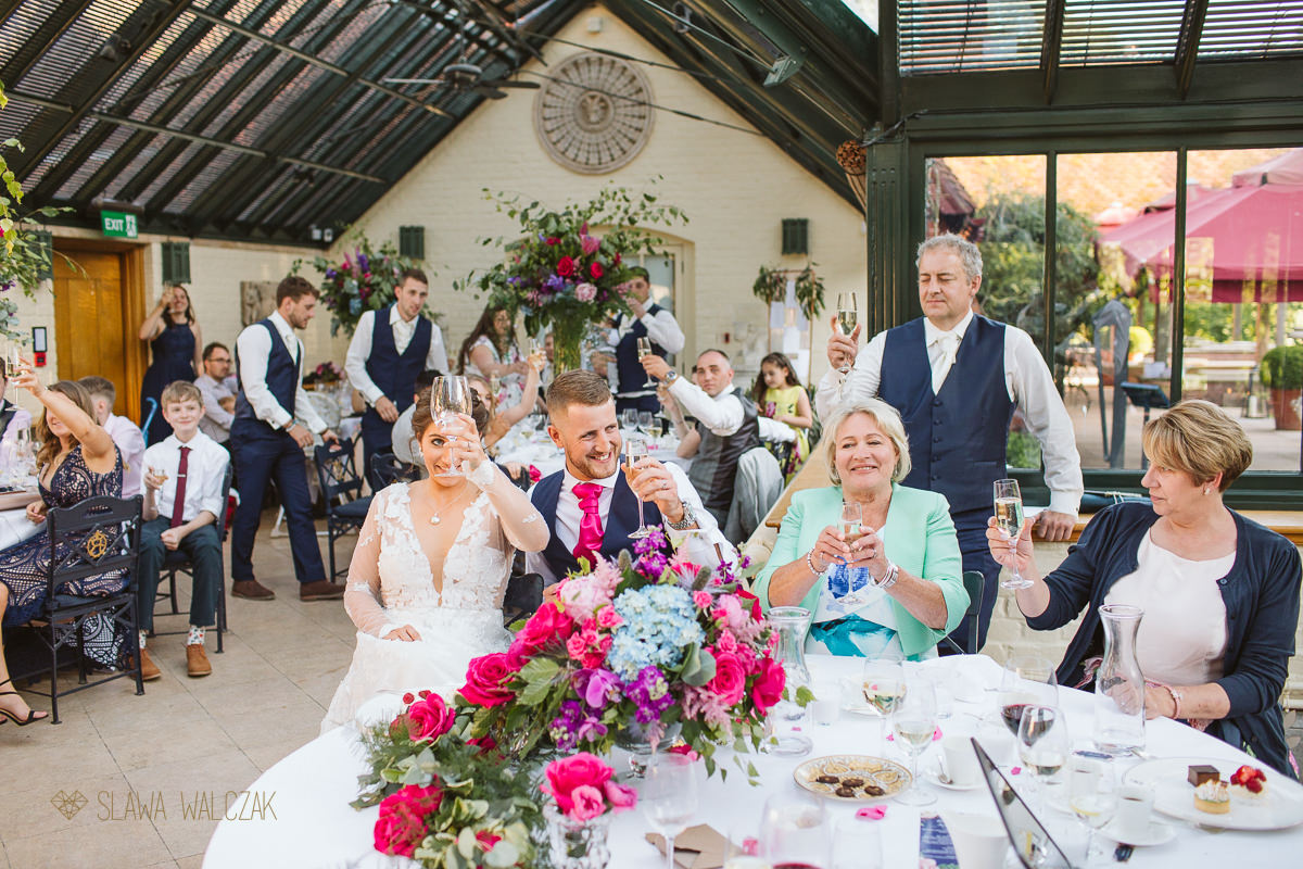 bride and groom make a toast The Dairy at Weddesdon Manor Wedding Photography