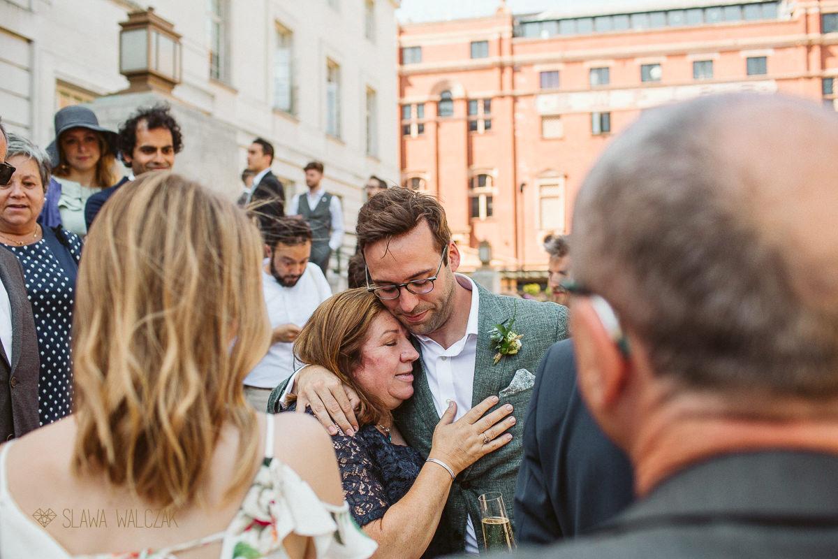 groom cuddling his mum at a Hackney Town Hall Wedding photography