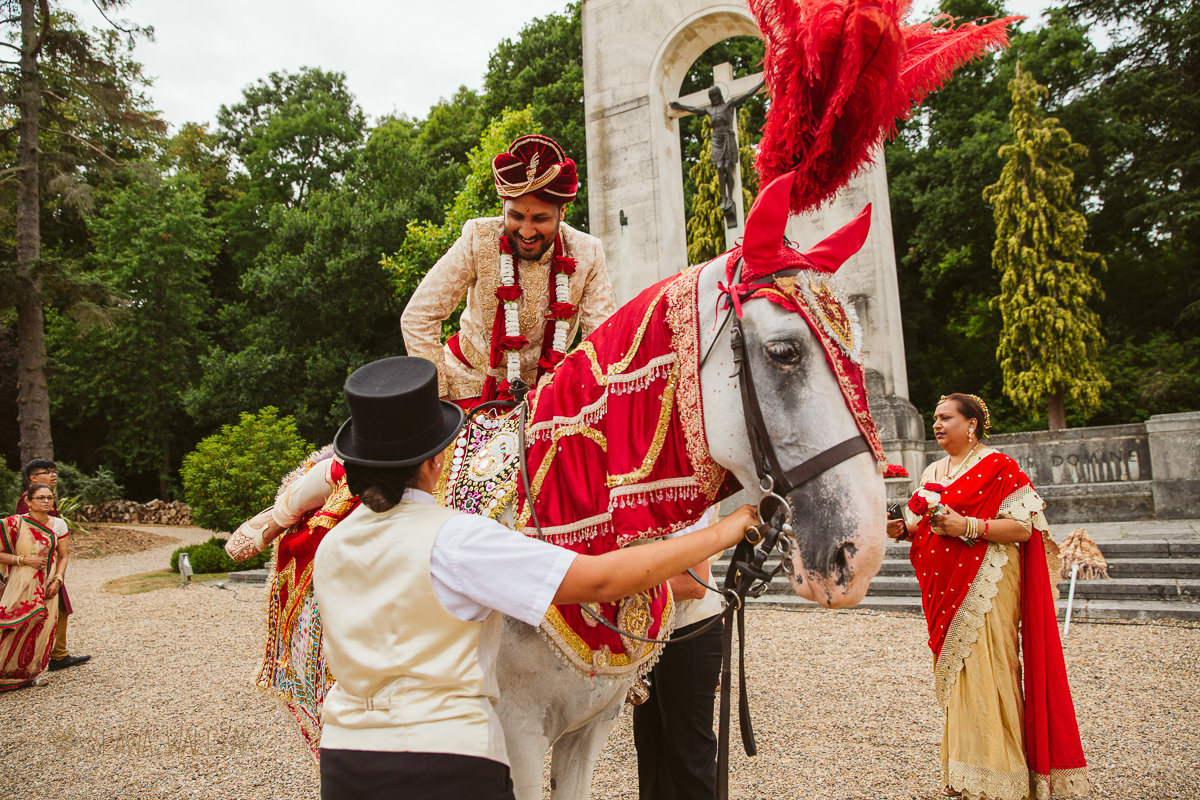 Baraat at an Indian Wedding in De Vere Beaumont Estate