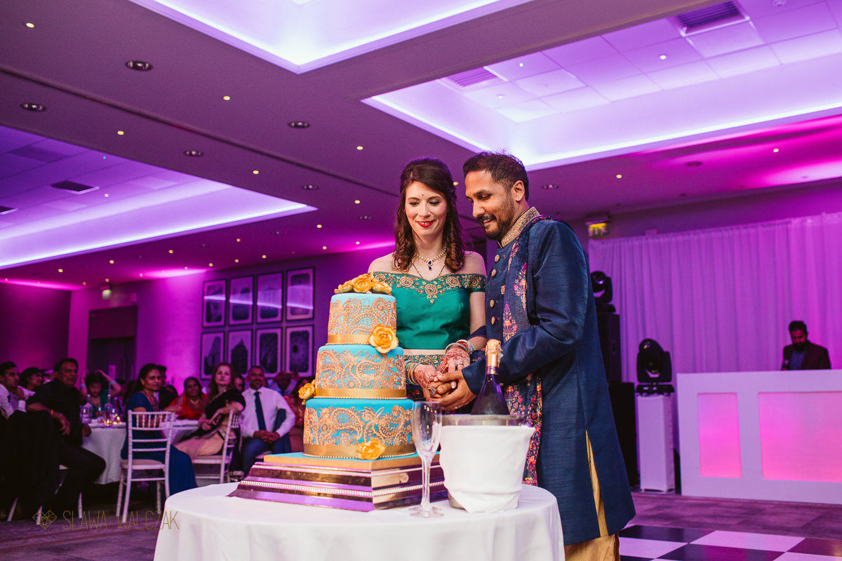 cake cutting at De Vere Beaumont Estate Indian Wedding Photography