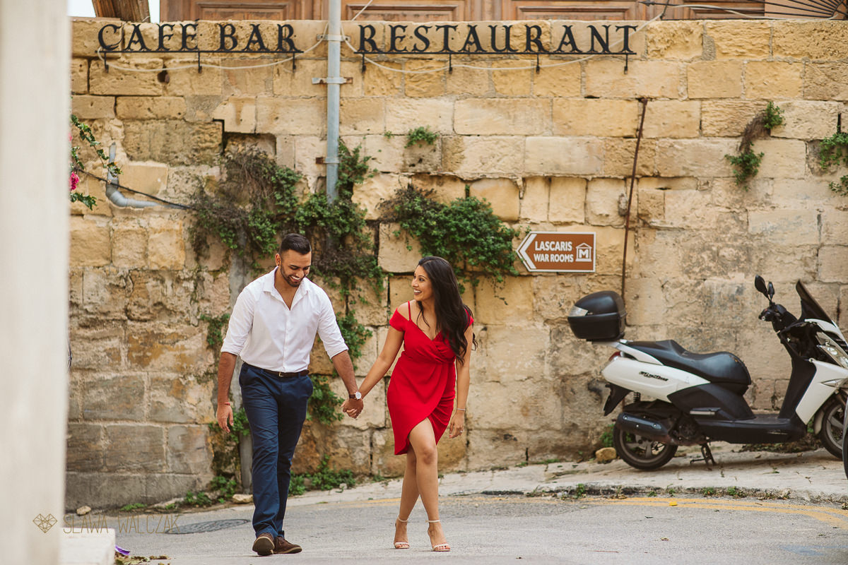 Couple posing for their engagement photos on the streets of Valletta in Malta