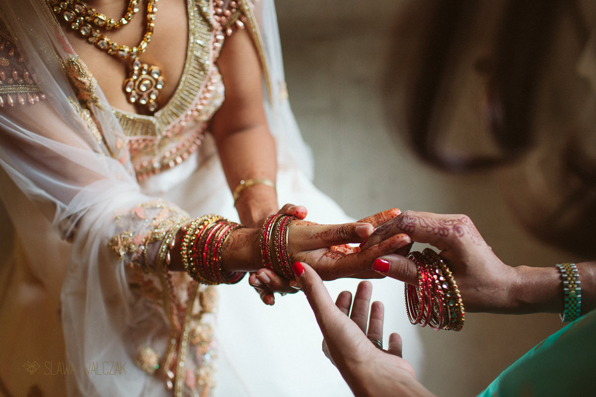 Hindu bride putting up her bangles at a wedding in Chiswick House