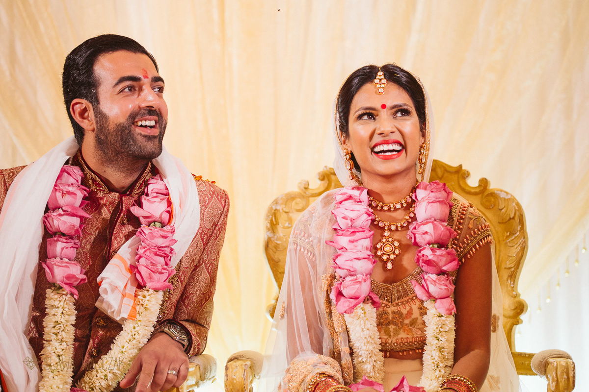 Indian bride and groom happy during ceremony