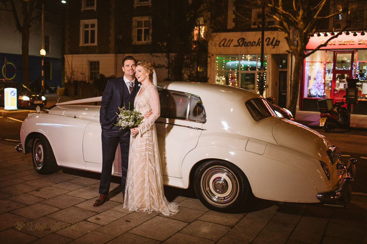 couple photos with Retro car at a London Wedding