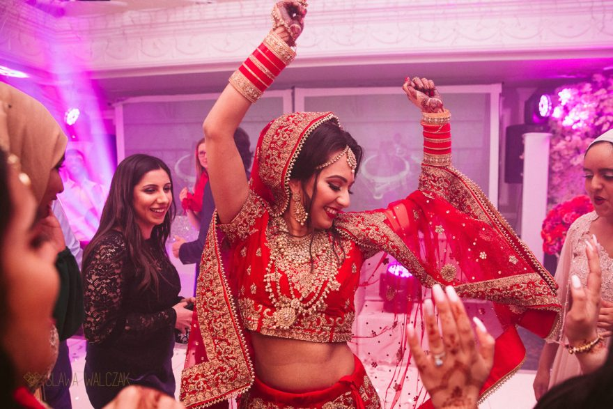 photo of a Sikh Bride dancing at a Luxury Asian Wedding