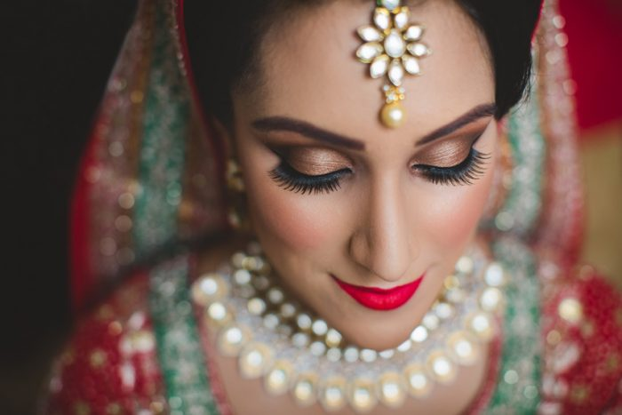 sikh punjabi bride posing for a portrait photo during her asian london wedding