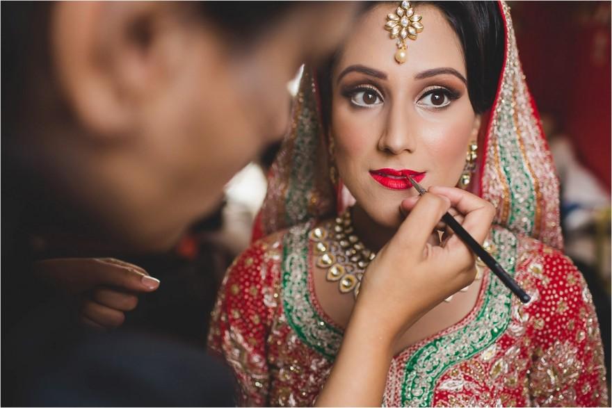south asian punjabi bride getting ready for her wedding in southall gurdwara