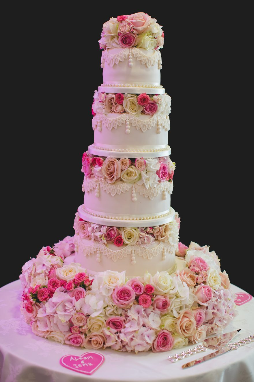 wedding cake decorated with real flowers