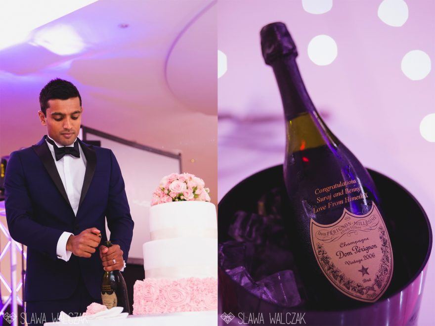 elegant groom opening a celebratory bottle of champagne