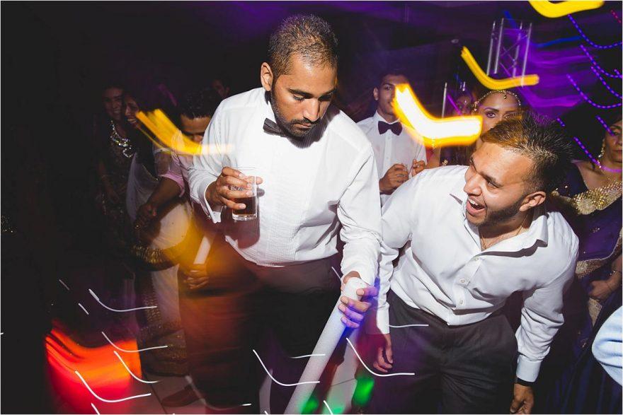 asian guys rocking the danecfloor at hindu wedding