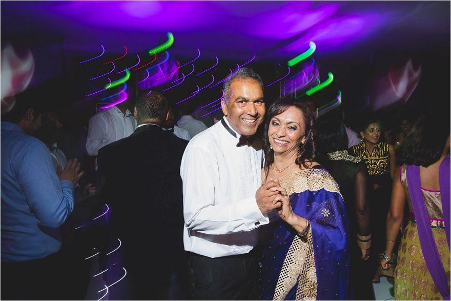 bride parents dancing at an indian wedding