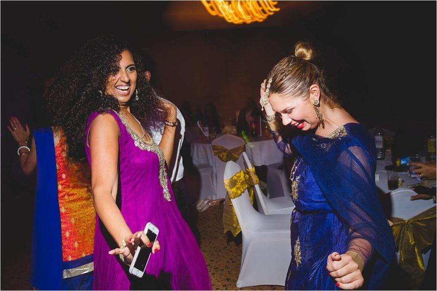 two pretty ladies enjoying the wedding reception party