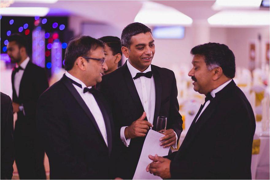 gents talking at an asian wedding