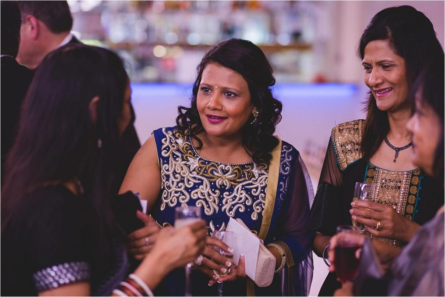 indian lady talking to wedding guests