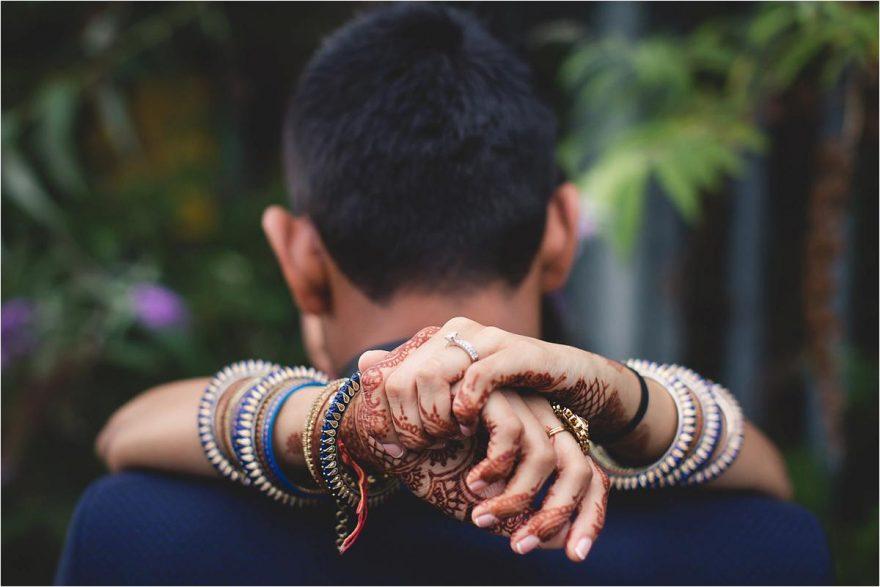 close up of henna hands at asian wedding