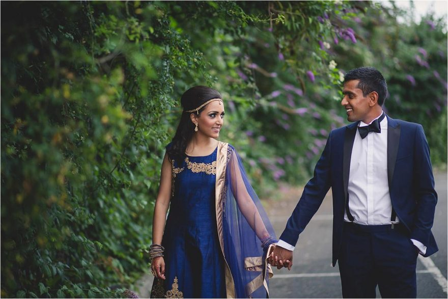 walking photo of a newly wed asian couple