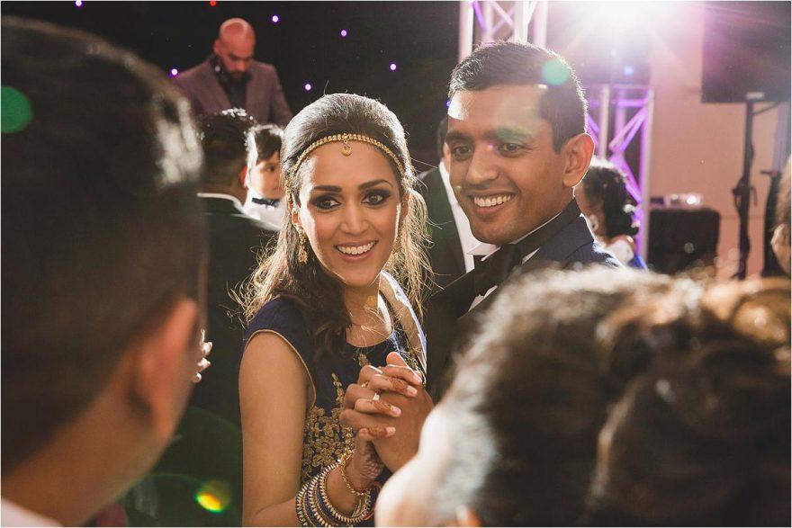 smiley bride and groom dancing on the dancefloor